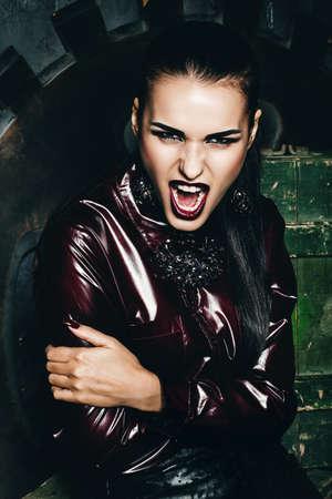 claret: screaming aggressive woman in claret shirt