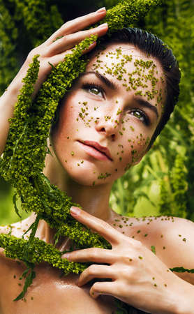healthy sensual woman with plant around face photo