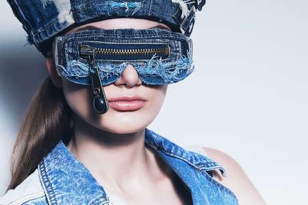waistcoat: portrait of woman in denim sunglasses