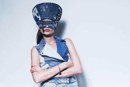 waistcoat: woman in denim hat and waistcoat