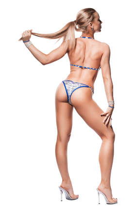 sporty woman in blue panties holding tail on white background photo