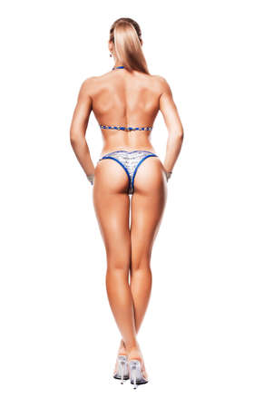 standing sporty woman from back on white background photo