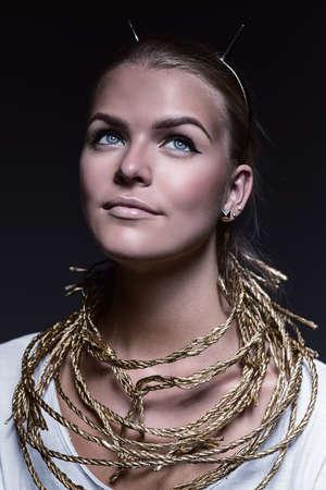 headband: blond woman in headband with horns Stock Photo