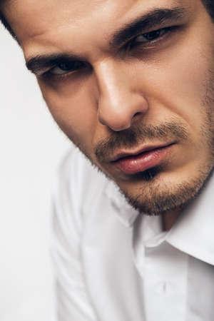 brown  eyed: close up portrait of brown eyed man