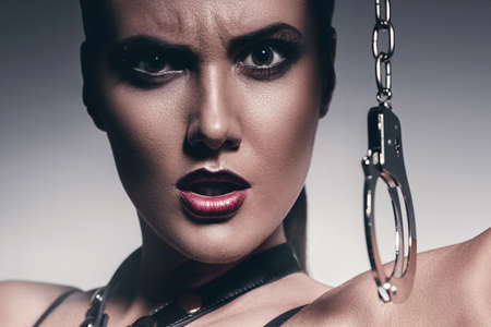handcuffs female: angry woman with handcuffs