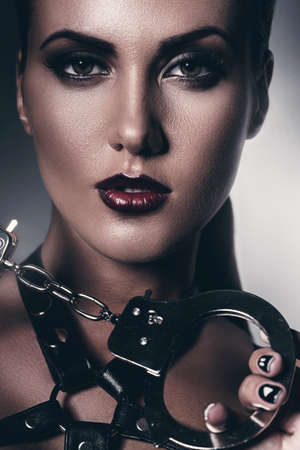 gothic fetish: hot woman with handcuffs Stock Photo