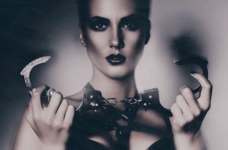 bdsm: old-fashioned portrait of woman with handcuffs Stock Photo