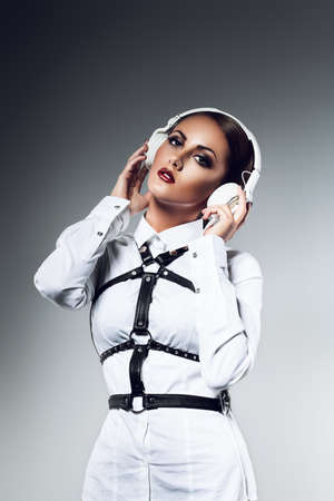 ladies bust: woman with white headphones
