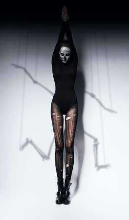 torn stockings: woman in skull make-up and skeleton shadow Stock Photo