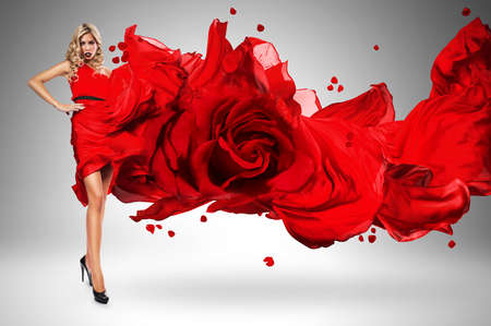 wind blown hair: blond woman in beautiful blown rose dress