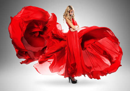 long red hair woman: blond woman in long beautiful red dress