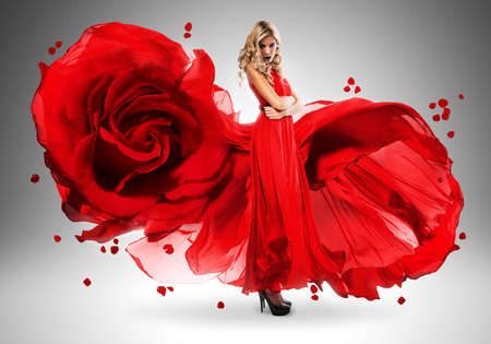 wind blown hair: blond woman in long beautiful rose dress