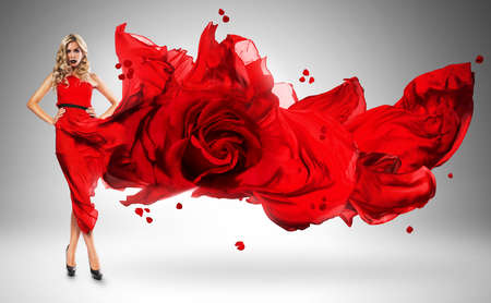 wind blown hair: blond woman in windy red rose dress