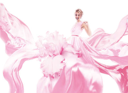 happy woman with pink dress in light
