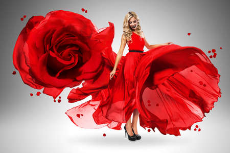 wind blown hair: smiling woman in large flying rose dress