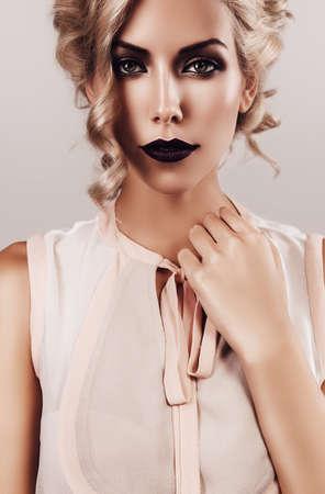 beige lips: woman in beige blouse with dark lips