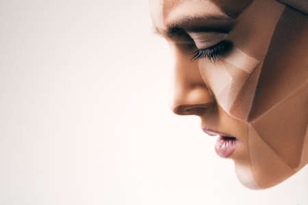 bodyart: attractive sensual woman with bodyart on face