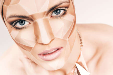 bodyart: beautiful woman with geometrical bodyart on face