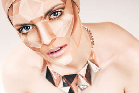 bodyart: sensual woman with geometrical bodyart on face Stock Photo