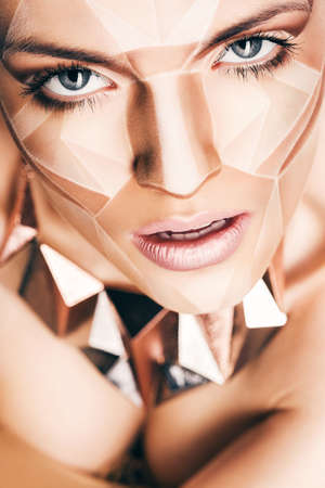 bodyart: sexy woman with geometrical bodyart on face