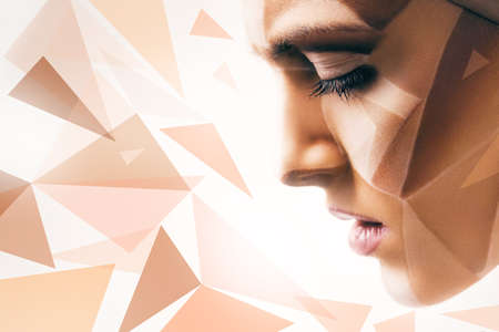 bodyart: woman with bodyart on face and geometric pattern in light