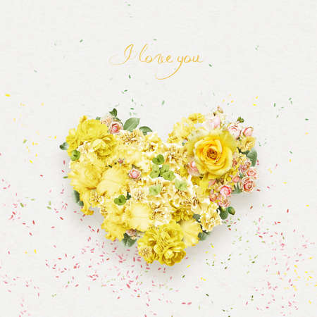 st valentine's day: heart of beautiful yellow and pink flowers on st valentines day Stock Photo