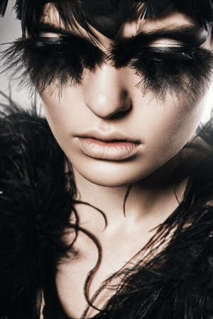 mysterious woman: mysterious woman with black feathers of face