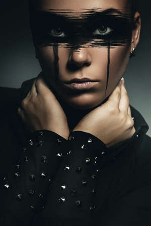 portrait of woman in black blouse with metal photo