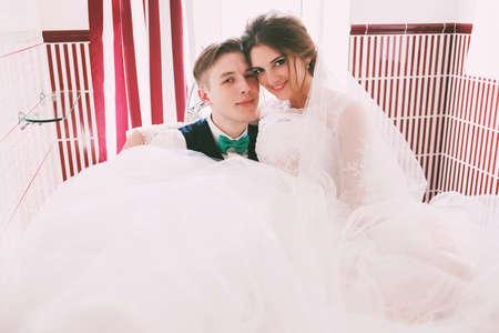 honeymoon suite: groom and bride lying in bathroom