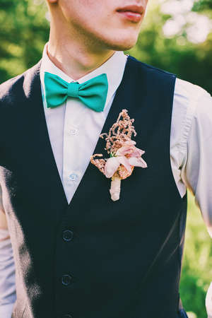 boutonniere: groom with bow tie and boutonniere