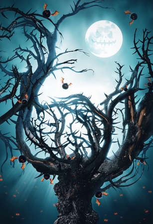 woodland  horror: mystic tree with moon and flying bats Stock Photo