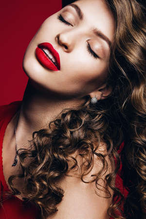 hot sensual woman with red lips on red background Stock Photo