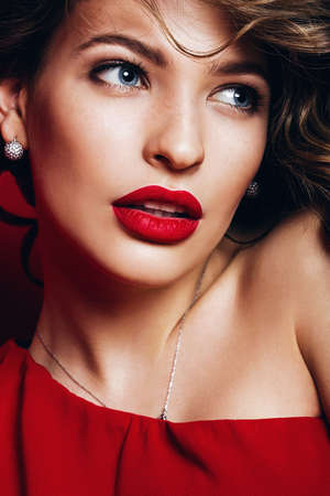 portrait of woman with passionate red lips and blue eyes