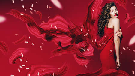 woman in red dress with abstract brushstrokes and petals on red background Stock Photo