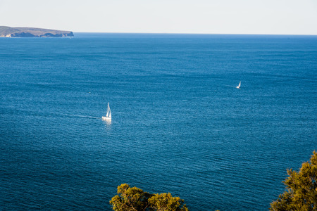 Scenic ocean panorama, sailing boats, Sydney North. Panoramic Daytime View from West Head Lookout to Broken Bay, Australia.