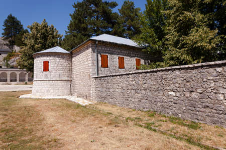 red shutters: part of the building of the monastery - a monastery, located in Cetinje, Montenegro