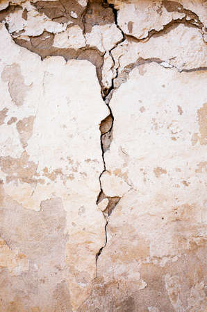collapsing: a building wall which started collapsing gradually. old building. Stock Photo