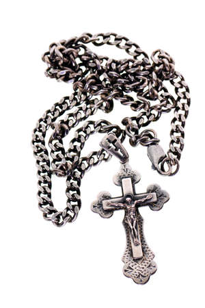 cross tribal tattoo: photographed by a close up an orthodox dagger on a chain. silver products