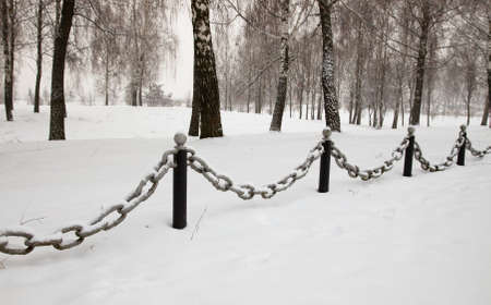 restrictive: restrictive pillars and chain in the Park during the winter