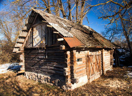 rural areas: the old wooden shed located in rural areas. Belarus Stock Photo