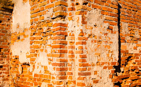 collapsing: the old brick wall collapsing eventually