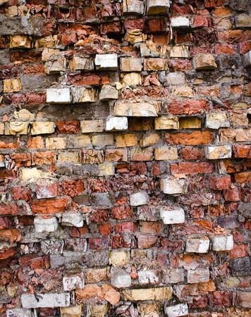 pared rota: fotografiado de cerca parte de la construcción de ladrillos de piedra