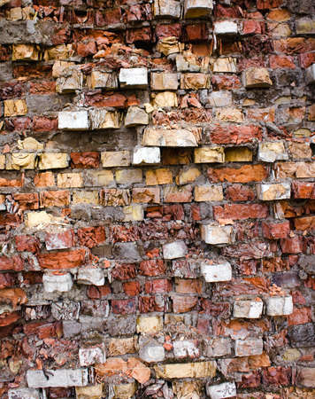 ancient brick wall: photographed close up part of the building of stone bricks