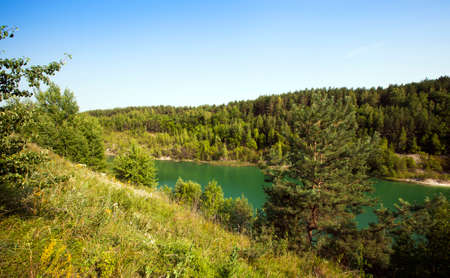 pits: the flooded pits with green water. were formed after chalk production. Belarus