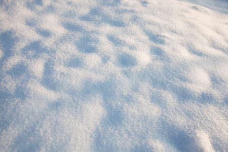 recently: the snowdrifts formed after recently passed snow stormbig snowdrifts - the snowdrifts formed after recently passed snow storm Stock Photo