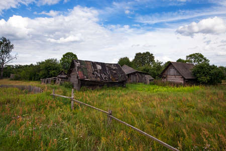 rural areas: the ancient wooden thrown house located in rural areas. Belarus Stock Photo