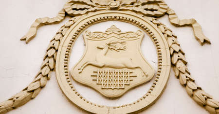 city coat of arms: the ancient municipal coat of arms of Grodno  located on one of ancient buildings of the city
