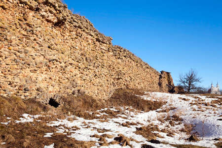 fastness: the ruins of an ancient fortress  is located in the village of Krevo. Belarus. Winter season Stock Photo