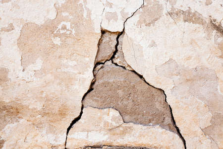 parget: photographed close-up of a crack in the plaster walls of the old building. Stock Photo