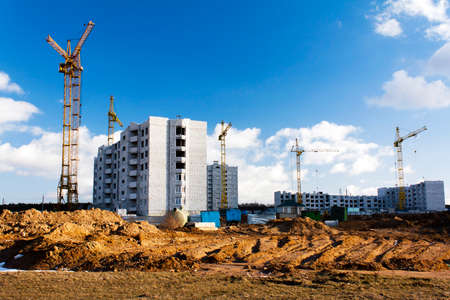 steel building: construction of a new residential building in the small town. Belarus Stock Photo